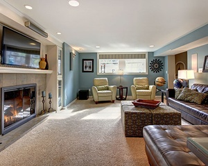 Area rug in large cozy tv room